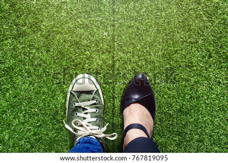 Life Balance concept for Work and Travel present in top view position over green grass field by half of Business Working Woman and Sneaker Shoes #767819095