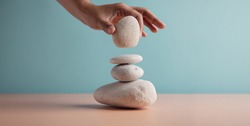 Life Balance Concept. Hand Setting White Natural Zen Stone Stack. Balancing Mind, Soul and Spirit. Mental Meditation Practice