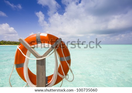 life belt at the sea with island blue sky and clouds