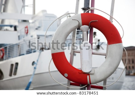 Life belt, passenger ship in the background