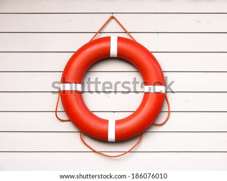 life belt, rescue ring (36) on wooden wall