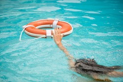 Life buoy, concept of help, rescue. Lifebuoy in water. Life ring floating in a sea, life preserver. Rescue ring. Rescuering, Safety ring in blue water