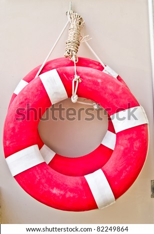 Life buoy hanging on a wall ready for use
