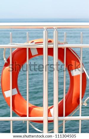 Life buoy on board - stock photo