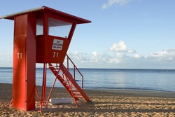 Life guard stand at sunrise on the beach