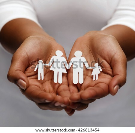 life insurance, love and charity concept - closeup of womans cupped hands showing paper man family #426813454