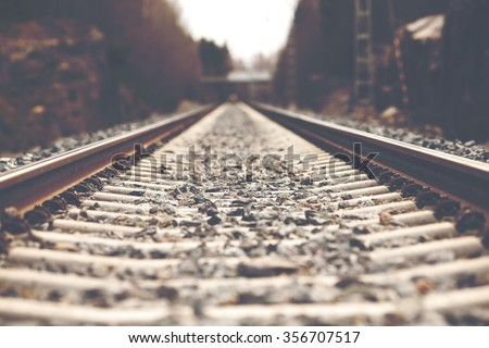 Life is a journey as a thought. Image of an empty railroad taken from low point of view. Also image has a vintage effect.