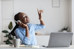 Life Is Good. Cheerful Black Female Entrepreneur Listening Music At Workplace And Dancing, Happy African Business Lady Wearing Headphones In Office, Sitting With Eyes Closed, Enjoying Favorite Songs