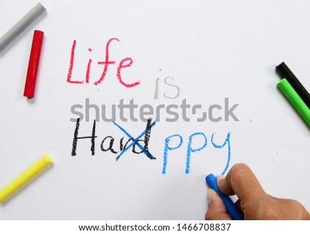 Life is Hard or Happy word, oil paint, writing, red, black, blue, child hand, motivational inspirational quotes words, words typography lettering concept for business, website, education and other.