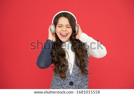 Life is song, sing it. Happy child sing song red background. Little girl listen to song in headphones. Modern life. New technology. Music and song. Fun and entertainment.