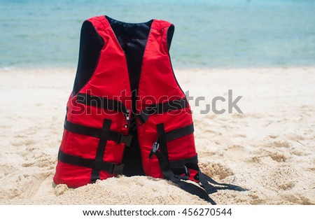 Life jacket and a mask for snorkeling on the beach #456270544