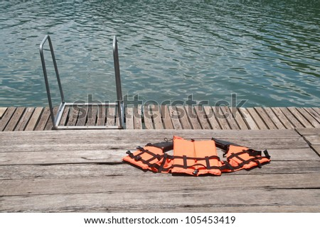 life jacket on floor ,swimmingpool