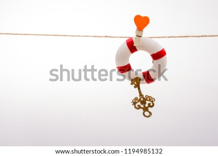 Life preserver attached to a string with heart icon #1194985132
