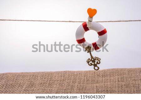 Life preserver attached to a string with heart icon #1196043307