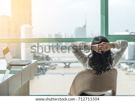 Life quality, living balance and carefree mental health concept with woman take it easy working and resting in luxury business city hotel or at home office with computer pc laptop on desk