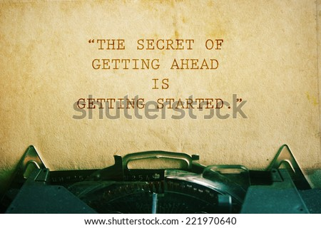 life quote. Inspirational quote on vintage paper background. Motivational background. The secret of getting ahead is getting started.