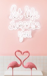 life quote with pink flamingo as heart shape and pink wall