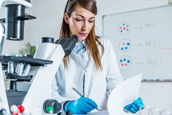Life sciences, researcher taking observation notes