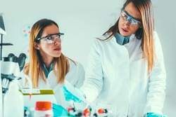 Life sciences, researchers taking observation notes