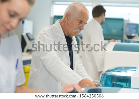 life scientist researching in laboratory