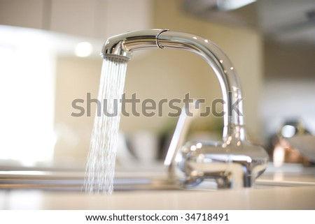 LIFE STYLE-a kitchen faucet with water flowing