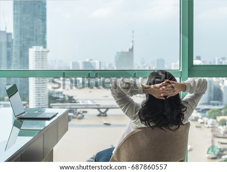 Life-work balance and carefree mental health concept with woman take it easy working and  resting in luxury business hotel at home office with computer pc laptop on desk