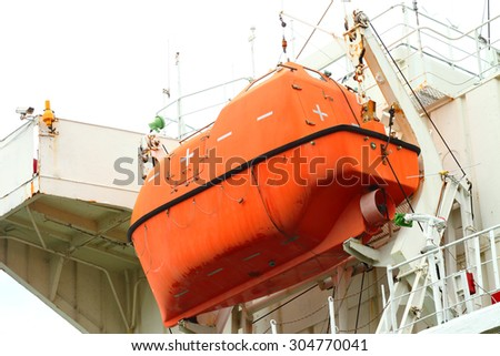 Lifeboat hanging on a deck of vessel.  #304770041
