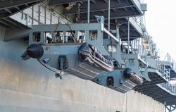 Lifeboat hanging on battle ship at port