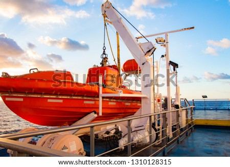 Lifeboat on a ferry ship. Safety boat on a ferry ship Colorful, vibrant picture