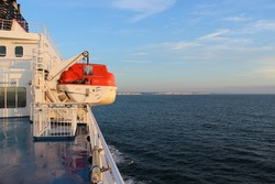 Lifeboat on deck of a cruise ship, English Channel
