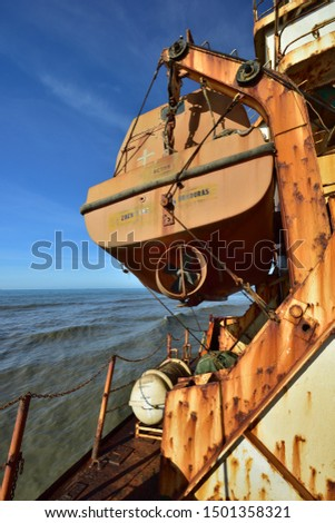 Lifeboat window landscape with stranded ship