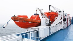Lifeboats by deck of a cruise ship
