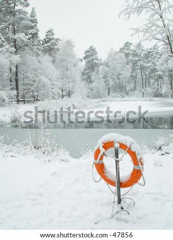 Lifebuoy at frozen pond