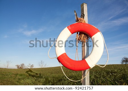 Lifebuoy at side of a pond