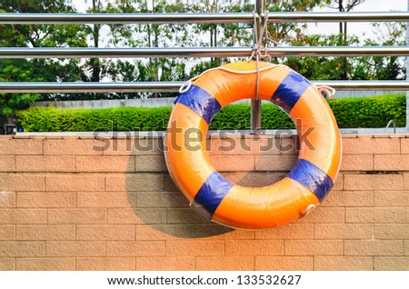 Lifebuoy attached to a swimming pool wall