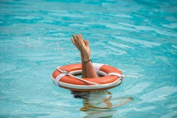 Lifebuoy help to survive concept. Support survival or save, rescue. Ring floating in a sea, life preserver. Drown people with rised hand