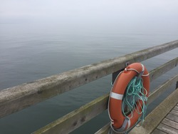 lifebuoy on peer at baltic sea