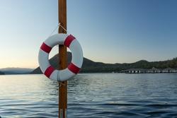 Lifebuoy on the Pole ,Lake Background