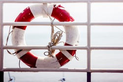 lifebuoy on the railing of the ship