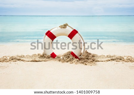 Lifebuoy On The Sandy Beach In Front Of Idyllic Sea #1401009758