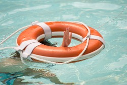 Lifebuoy or buoy helping to survive concept. Support survival or save, rescue. Ring floating in a sea, life preserver. Drown people with rised hand