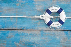 Lifebuoy tied with a rope - blue background for cruising