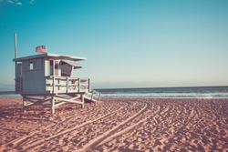 Lifeguard cabin on Santa Monica beach in California on sunset, retro toned