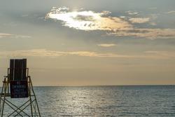 Lifeguard Chair on beach at sunset