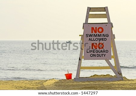 lifeguard chair with sign saying no swimming
