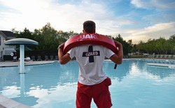 Lifeguard having fun at the pool while there are no visitors
