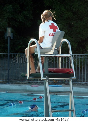 lifeguard keeping watch at pool