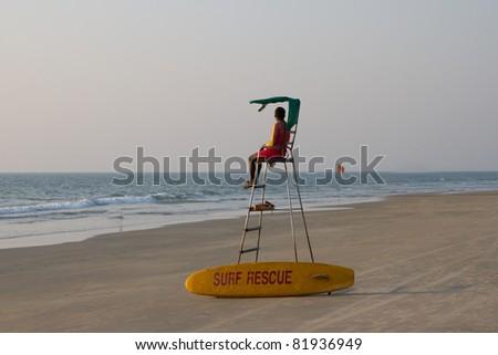 Lifeguard overlooking tropical beach, Goa India - stock photo