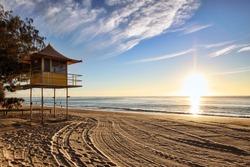Lifeguard patrol tower on the beach at sunrise, Gold Coast, Australia