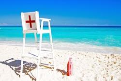 Lifeguard sign on the beach. Safe Travelling. Cancun Beach. Insurance Traveler.